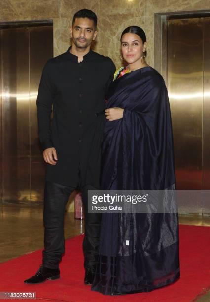 Indian actor Angad Bedi and Neha Dhupia attend film producer Ramesh Taurani's Diwali bash on October 23, 2019 in Mumbai, India.