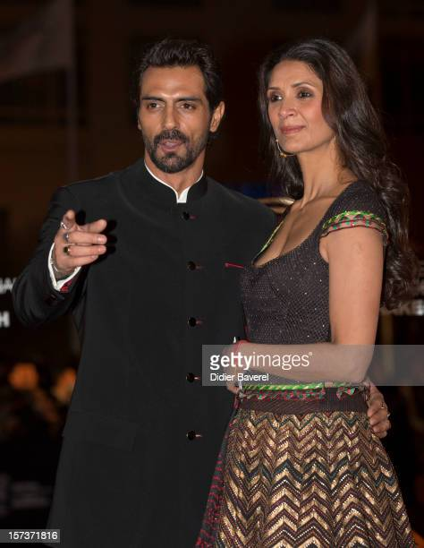 Indian actor Arjun Rampal and his wife Mehr Jessia attend the Tribute to Hindi Cinema ceremony at the 12th Marrakech international Film Festival on...