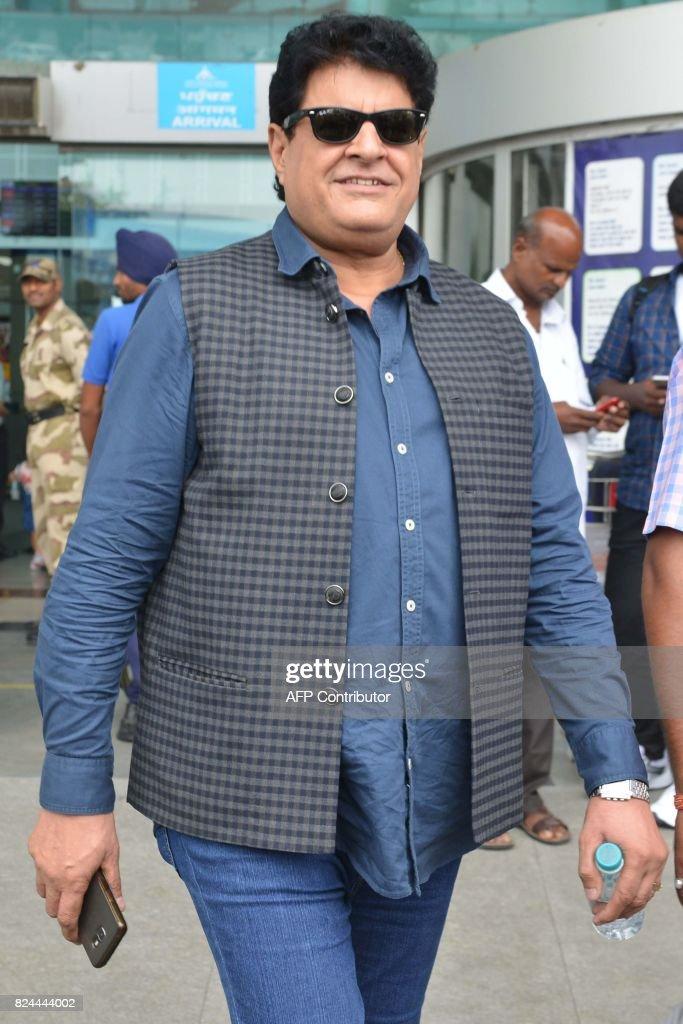 Indian actor Gajendra Chauhan arrives at Shri Guru Ram Das Ji International Airport in Amritsar on July 30 2017 / AFP PHOTO / NARINDER NANU