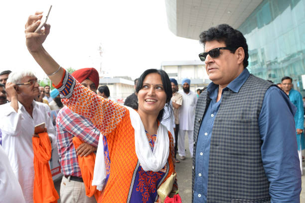 Indian actor Gajendra Chauhan takes a selfie with a fan after arriving at Shri Guru Ram Das Ji International Airport in Amritsar on July 30 2017 /...