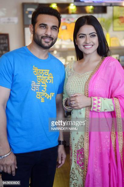 Indian actor Harish Verma and actress Simmi Chahal pose during a promotional event for the upcoming Punjabi film 'Golak Bugni Bank Te Batue' in...