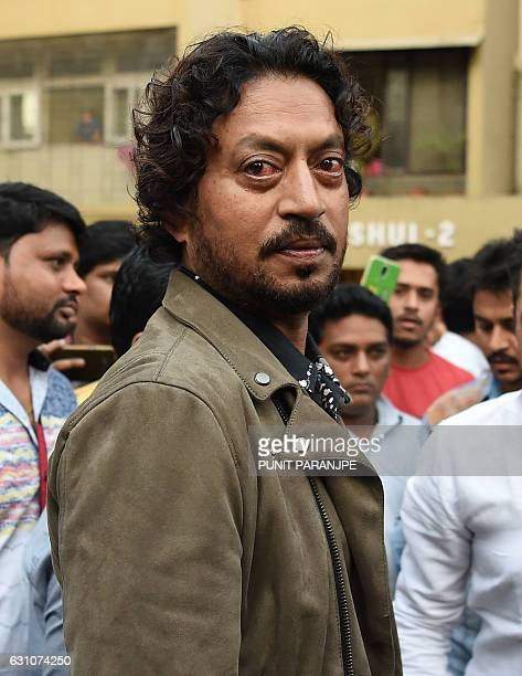 Indian actor Irrfan Khan arrives to pay last respects to the deceased Indian actor Om Puri for his funeral in Mumbai on January 6 2017 Om Puri the...