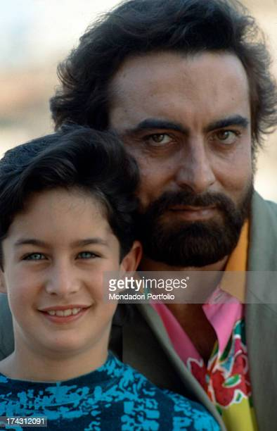 Indian actor Kabir Bedi and his son the American model Adam Bedi smiling and posing 1990