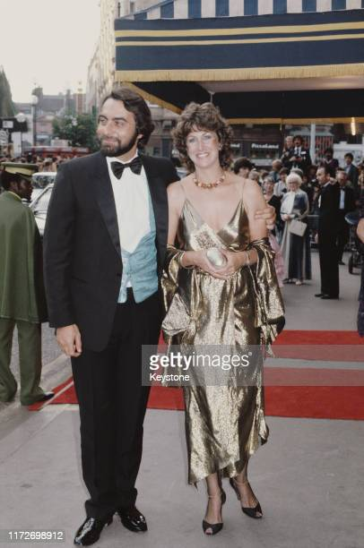 Indian actor Kabir Bedi attends the premiere of the James Bond film 'Octopussy' at the Odeon Leicester Square with his partner fashion designer Susan...