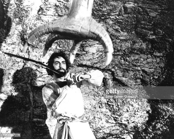 Indian actor Kabir Bedi fights off a giant bird claw in the fantasy film 'The Thief of Baghdad' 1978