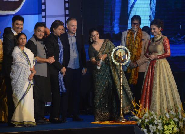 Indian Actor Kajol lights the lamp with Amitabh Bachchan Kamal Hasan Shah Rukh Khan West Bengal Chief minister Mamata Banerjee during the...