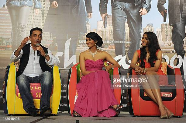 Indian actor Kamal Haasan speaks as costars Pooja Kumar and Andrea Jeremiah watch on during a news conference to promote his new film 'Vishwaroop'...