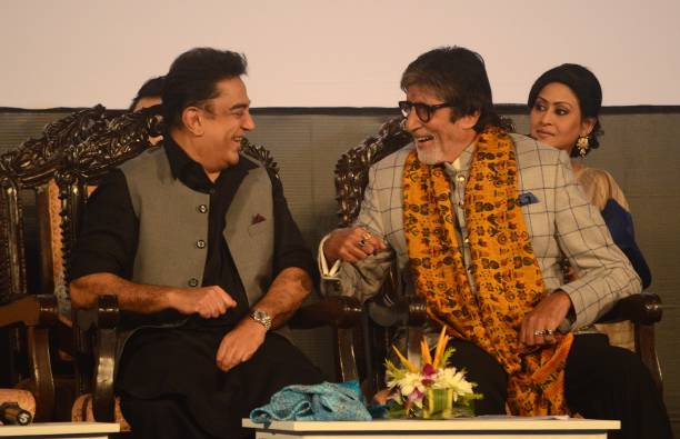 Indian Actor Kamal Hasan and Amitabh Bachchan sharing moments during the inauguration ceremony of 23rd Kolkata International Film Festival in Kolkata.