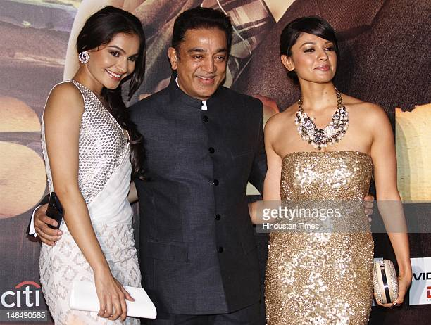 Indian actor Kamal Hasan flanked by his costars Pooja Kumar and Andrea Jeremiah during the World Premier of Shanghai on the first day of 13th...