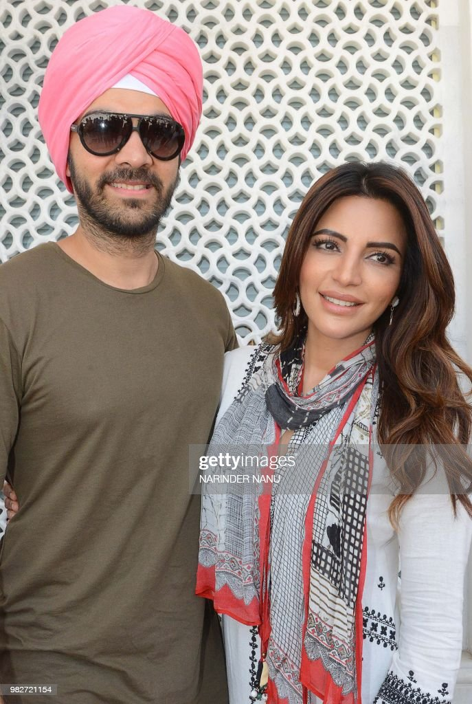 Indian actor Karan V Grover and actress Shama Sikander pose during a promotional event for the web series `Ab Dil Ki Sunn` in Amritsar on June 24 2018