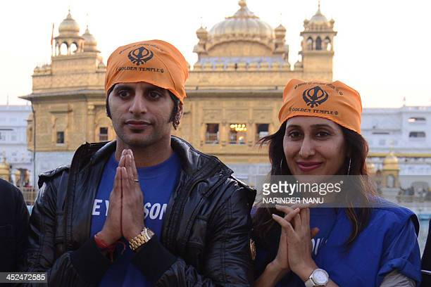Indian actor Karanvir Bohra and actress Teejay Sidhu pose as they pay their respects at Sikh Shrine The Golden Temple in Amritsar on November 29 2013...