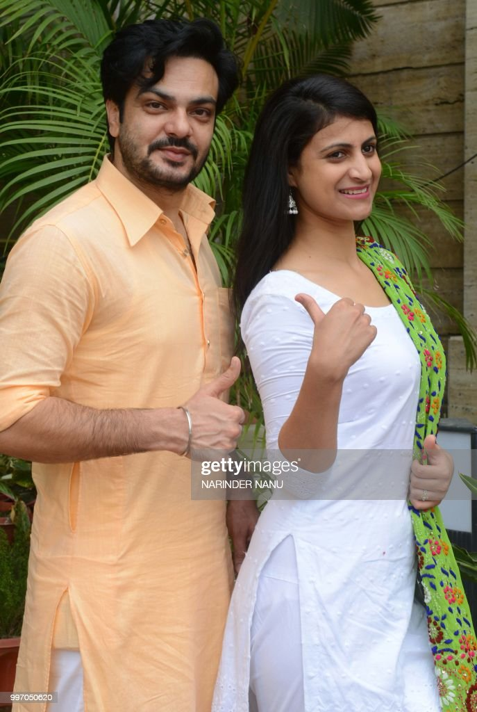 Indian actor Lakha Lakhwinder Singh and actress Pooja Thakur pose during a promotional event for the upcoming Punjabi film `Dhol Ratti` at a hotel in.