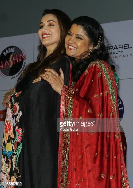 indian actor Madhuri Dixit and Renuka Shahane attends the speacial screening of 25th year of film Hum Aapke hain koun' on August 92019 in Mumbai India