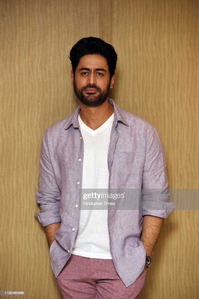 Indian actor Mohit Raina strikes a pose during the promotion