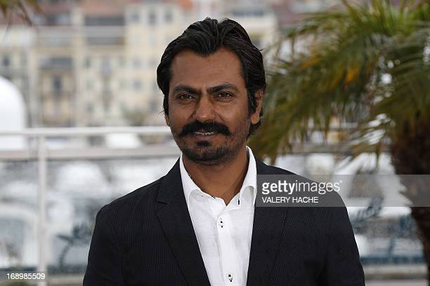 Indian actor Nawazuddin Siddiqui poses on May 18 2013 during a photocall for the film Monsoon Shootout presented Out of Competition at the 66th...