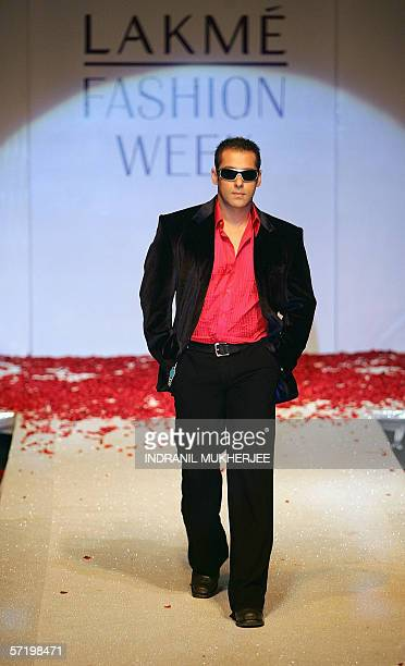 Indian actor Salman Khan walks the ramp at a show by Indian designer Surily Goel on the first day of the inaugural Lakme Fashion Week in Mumbai 28...
