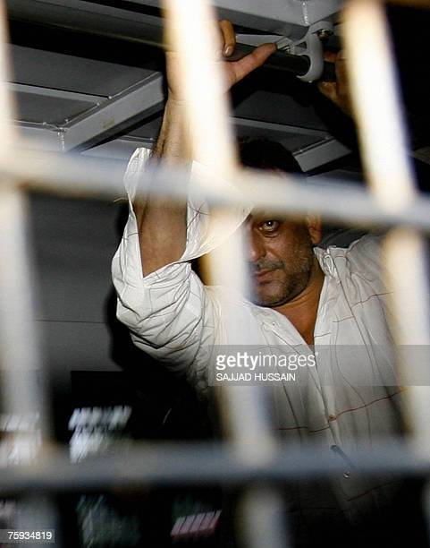 Indian actor Sanjay Dutt stands in a police van in Mumbai 02 August 2007 as he is moved from the city's Arthur Road jail to Yerawada Jail in the...