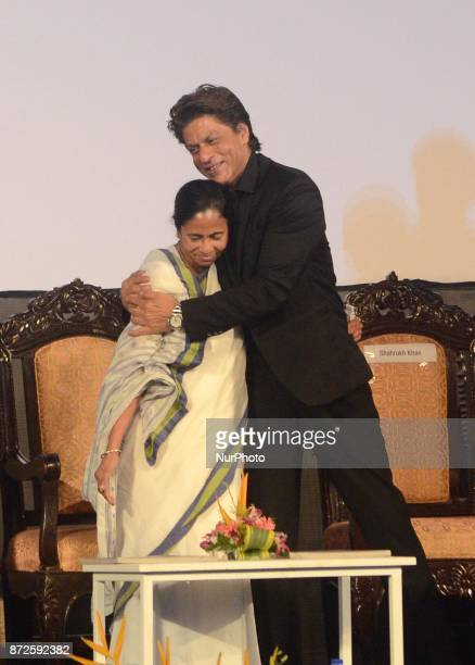 Indian Actor Shah Rukh Khan greets West Bengal Chief minister Mamata Banerjee during the inauguration ceremony of 23rd Kolkata International Film...