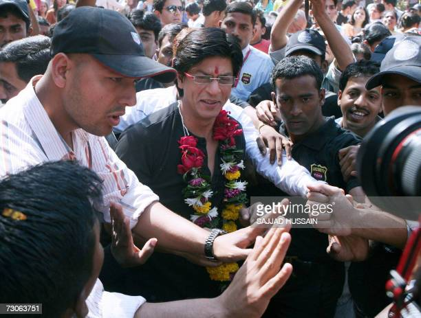 Indian actor Shah Rukh Khan is mobbed by fans as he arrives for a promotional event of the popular television quiz show Kaun Banega CrorepatiWho...