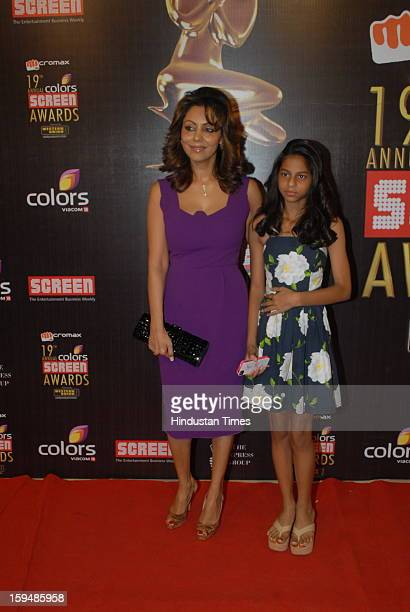 Indian actor Shahrukh Khans's wife Gauri and daughter Suhana Khan pose on red carpet at 19th Annual Colors Screen Awards on January 12 2013 in Mumbai...