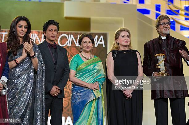 Indian actor Shahrukh Khan Sharmila Tagore French actress Catherine Deneuve Indian actor Amitabh Bachchan pose during the tribute to Hindi cinema at...