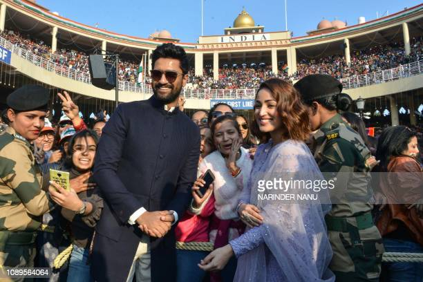 Indian actor Vicky Kaushal and bollywood actress Yami Gautam pose for photographs during the promotion of the upcoming film 'Uri' on the occasion of...