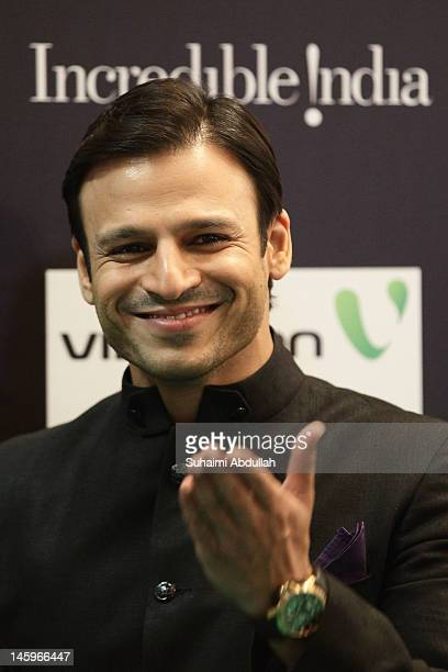 Indian actor Vivek Oberoi gestures on the green carpet during the IIFA Rocks Green Carpet on day two of the 2012 International India Film Academy...