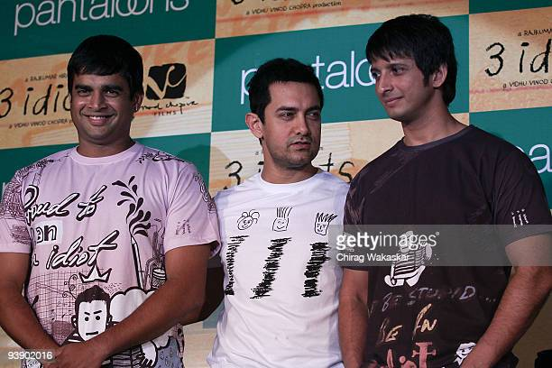 Indian actors Aamir Khan R Madhavan Sharman Joshi attend launch of Pantaloons '3 Idiots' Tshirt Collection held at Phoenix Mall on December 4 2009 in...