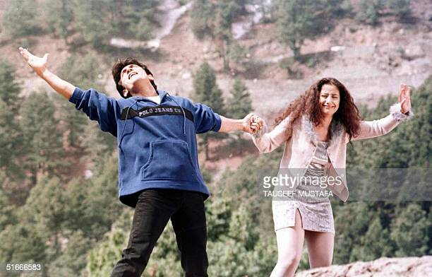 Indian actors Amir Khan and Monisha Querrilla perform a dance sequence during the filming of the movie 'Mann' in the city of Gulmarg in India's...
