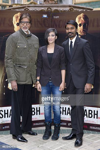 Indian actors Amitabh Bachchan Indian film actress Akshara Haasan and Indian film actor Dhanush pose for photographers at a photocall for the film...