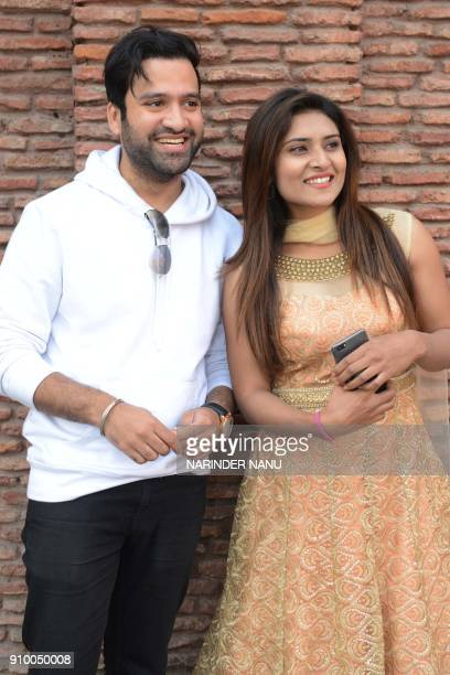 Indian actors Arsh Chawla and Khushi Malhotra pose for a photograph during a promotional event for the forthcoming Punjabi film 'Bhagat Singh Di...