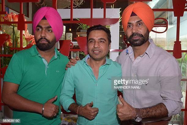 Indian actors Binnu Dhillon Ammy Virk and director Pankaj Batra pose during a promotional event for the upcoming Punjabi film 'Bambukat' in Amritsar...