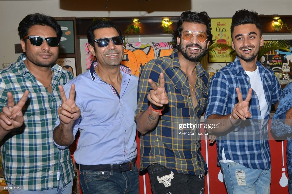 Indian actors Binnu Dhillon Dev Kharoud Yuvraj Hans and Ravneet Singh pose during a promotional event for the upcoming Punjabi film `Bailaras` at an..