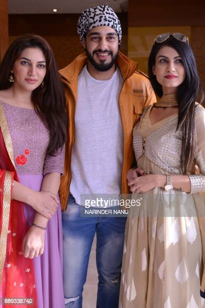 Indian actors Drishtii Grewal Neet Kaur and Chaitannya Kanhai pose for a photograph during a promotional event for the upcoming Punjabi film 'Hard...
