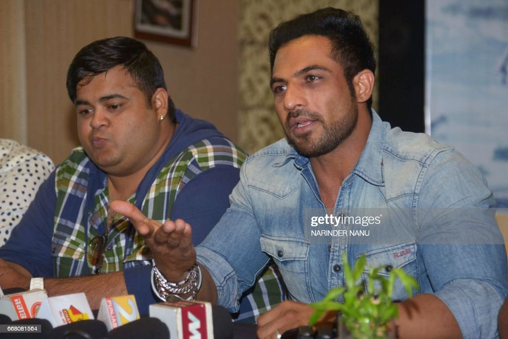 Indian actors Mohammad Nazim and Maninder Velly address a press conference for the upcoming Punjabi film `Big Daddy` in Amritsar on April 13 2017 /...