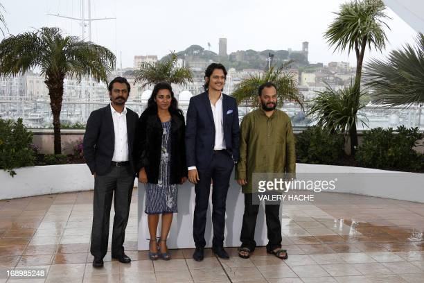 Indian actors Nawazuddin Siddiqui Tannishtha Chatterjee and Vijay Verma and director Amit Kumar pose on May 18 2013 during a photocall for the film...