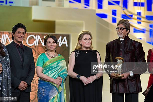Indian actors Shahrukh Khan Sharmila Tagore French actress Catherine Deneuve Indian actor Amitabh Bachchan pose during the tribute to Hindi cinema at...
