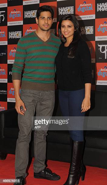 Indian actors Siddharth Malhotra and Parineeti Chopra pose during a promotional event for the upcoming film Hasse Toh Phasse in Ahmedabad on February...