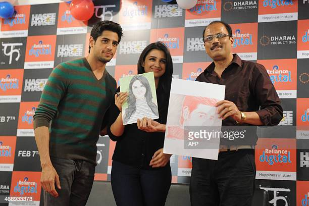 Indian actors Siddharth Malhotra and Parineeti Chopra pose with Indian sketch artist Vilas Jamindar during a promotional event for the upcoming film...
