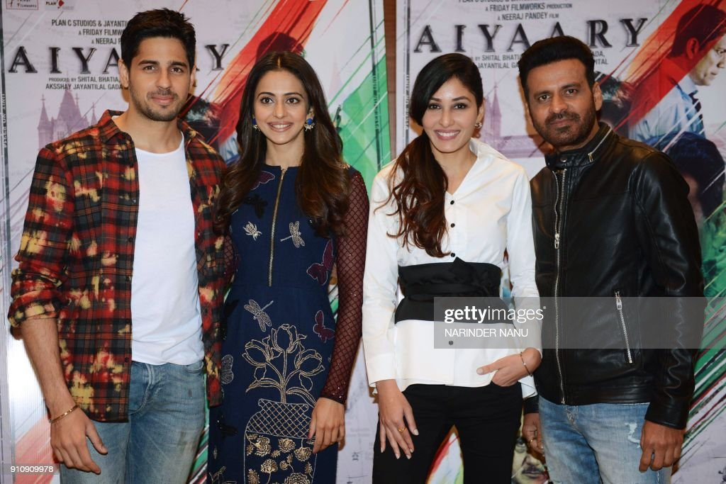 Indian actors Sidharth Malhotra Rakul Preet Singh Pooja Chopra and Manoj Bajpayee pose for a picture during a promotional event for the upcoming film.