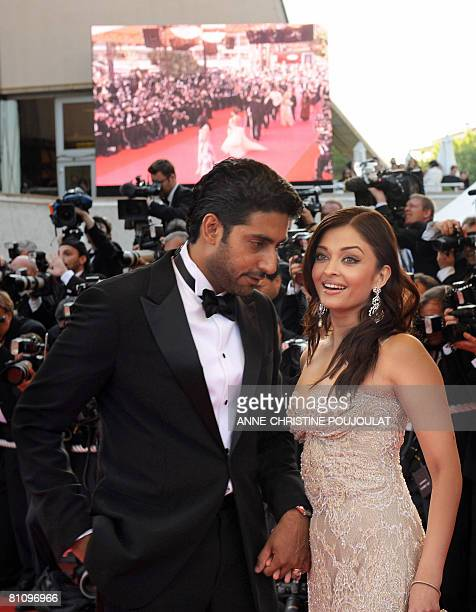 Indian actress Aishwarya Rai and her husband Indian actor Abhishek Bachchan arrive to attend the screening of US directors John Stevenson and Mark...