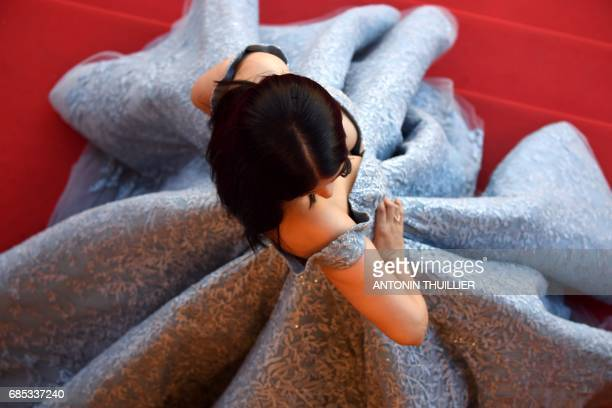 Indian actress Aishwarya Rai Bachchan poses as she arrives on May 19 2017 for the screening of the film 'Okja' at the 70th edition of the Cannes Film...