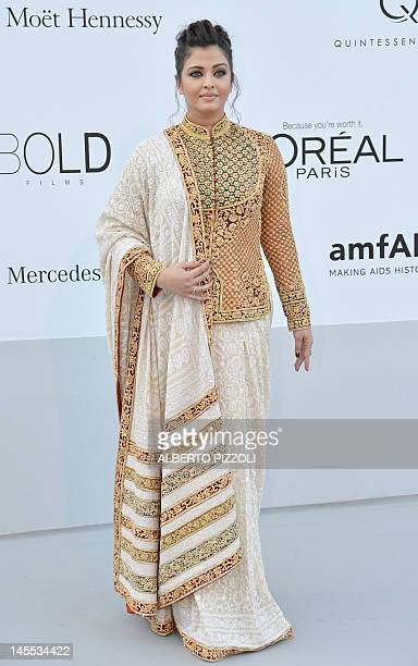 Indian Actress Aishwarya Rai Bachchan poses as she arrives to attend the 2012 amfAR's Cinema Against Aids on May 24, 2012 in Antibes, southeastern...