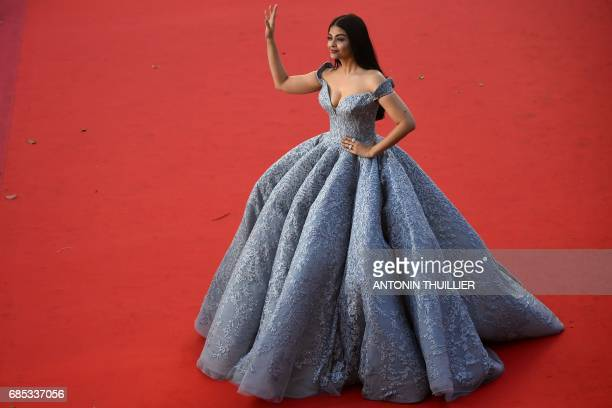 Indian actress Aishwarya Rai Bachchan waves as she arrives on May 19 2017 for the screening of the film 'Okja' at the 70th edition of the Cannes Film...