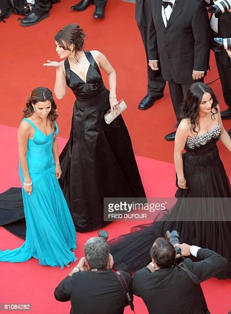 Indian actress Aishwarya Rai blows a kiss at photographers as she arrives with US actress Eva Longoria Parker and French actress Rachida Brakni to...
