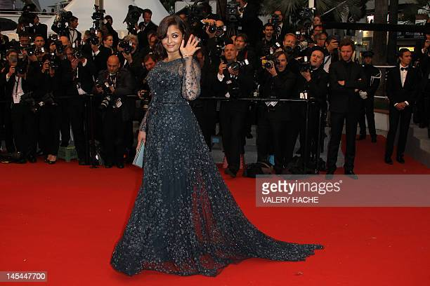 """Indian actress Aishwarya Rai waves as she arrives for the screening of """"Cosmopolis"""" presented in competition at the 65th Cannes film festival on May..."""