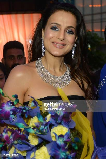 Indian actress Ameesha Patel holds flowers during a promotional event for a jewellery brand in Amritsar on October 7 2018