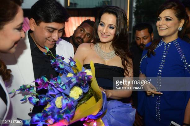 Indian actress Ameesha Patel receives flowers during a promotional event for a jewellery brand in Amritsar on October 7 2018