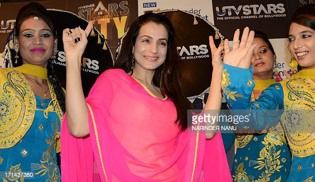 Indian actress Amisha Patel addresses the media during a press conference in Amritsar on June 24 2013 Patel visited the Punjabi city to promote...