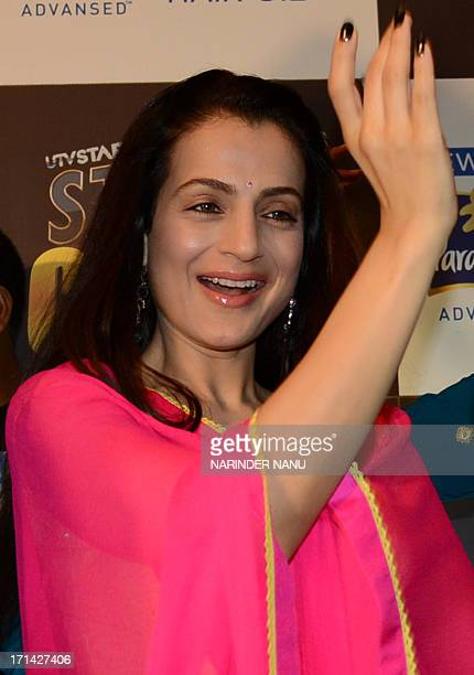 Indian actress Amisha Patel dances during a press conference in Amritsar on June 24 2013 Patel visited the Punjabi city to promote upcoming TV Serial...